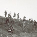 Farm workers posing during the stabilization of an embankment.